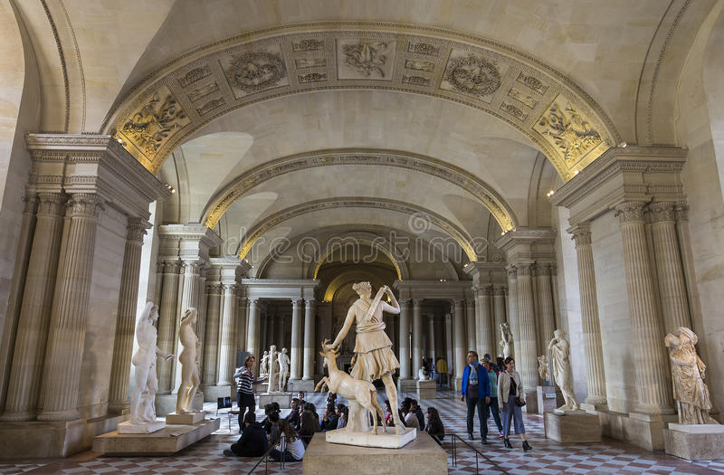The Caryatids room, The Louvre, Paris, France. A view in PARIS, FRANCE, MARCH 13, 2017 : architectural details of the caryatids room, the Louvre palace, march 13 stock photography