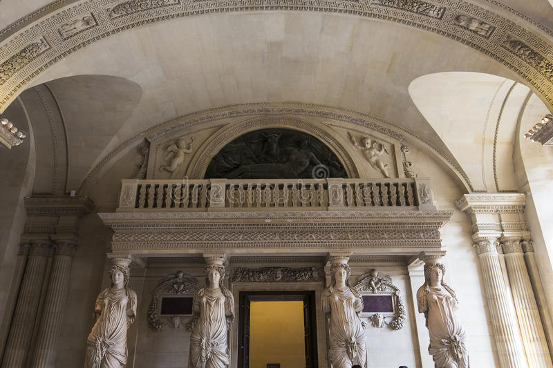The Caryatids room, The Louvre, Paris, France. A view in PARIS, FRANCE, MARCH 13, 2017 : architectural details of the caryatids room, the Louvre palace, march 13 royalty free stock photos