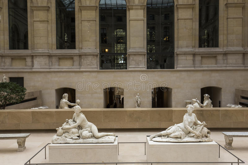The Caryatids room, The Louvre, Paris, France. A view in PARIS, FRANCE, MARCH 13, 2017 : architectural details of the caryatids room, the Louvre palace, march 13 royalty free stock image