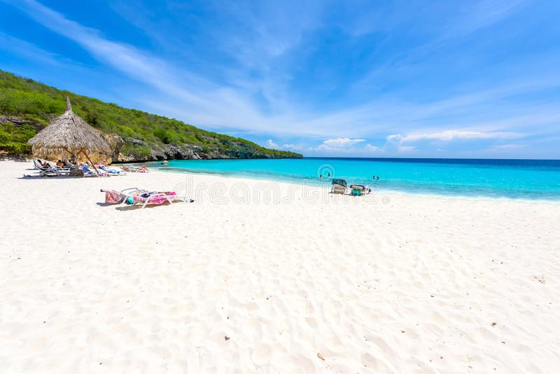 Cas Abao beach - paradise white sand Beach with blue sky and crystal clear blue water in Curacao, Netherlands Antilles, a. Caribbean tropical Island royalty free stock photo