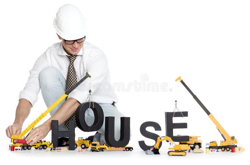 Acumule una casa: Dirija la casa-palabra del edificio. foto de archivo
