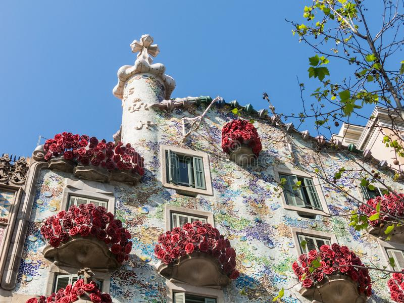 The Casa Batlló by Antonio Gaudí, decorated to celebrate the Day of the Rose in Catalonia. Paseo de Gracia, Barcelona. BARCELONA, SPAIN - APRIL 20: The Day stock photography