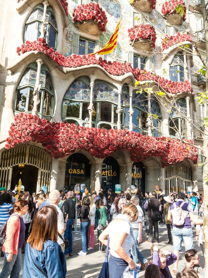 The Casa Batlló by Antonio Gaudí, decorated to celebrate the Day of the Rose in Catalonia. Paseo de Gracia, Barcelona. BARCELONA, SPAIN - APRIL 20: The Day stock photo
