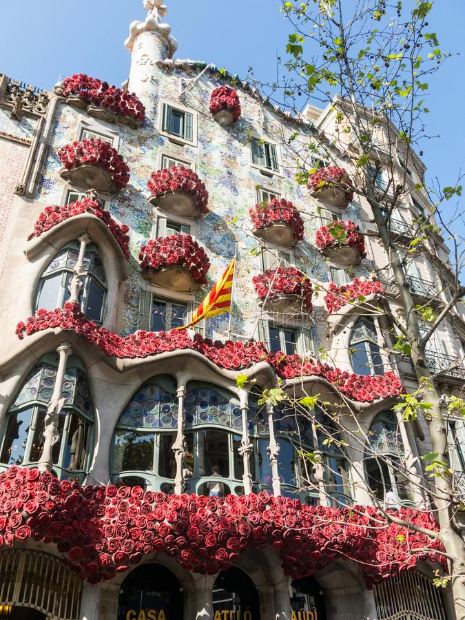 The Casa Batlló by Antonio Gaudí, decorated to celebrate the Day of the Rose in Catalonia. Paseo de Gracia, Barcelona. BARCELONA, SPAIN - APRIL 20: The Day stock images