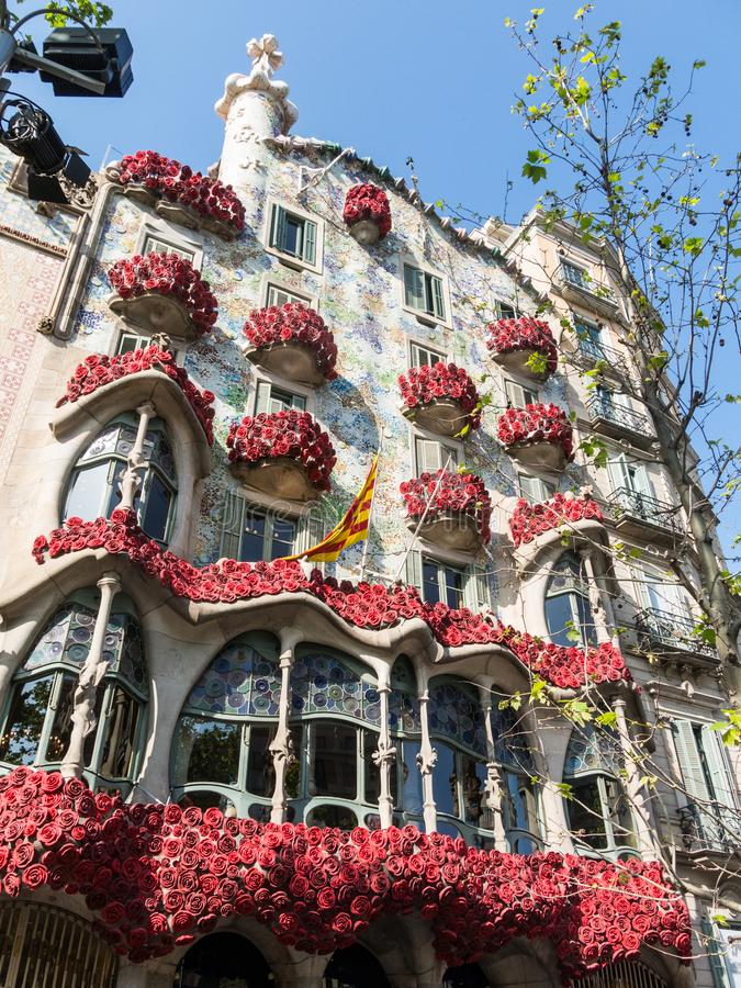 The Casa Batlló by Antonio Gaudí, decorated to celebrate the Day of the Rose in Catalonia. Paseo de Gracia, Barcelona. BARCELONA, SPAIN - APRIL 20: The Day royalty free stock photos