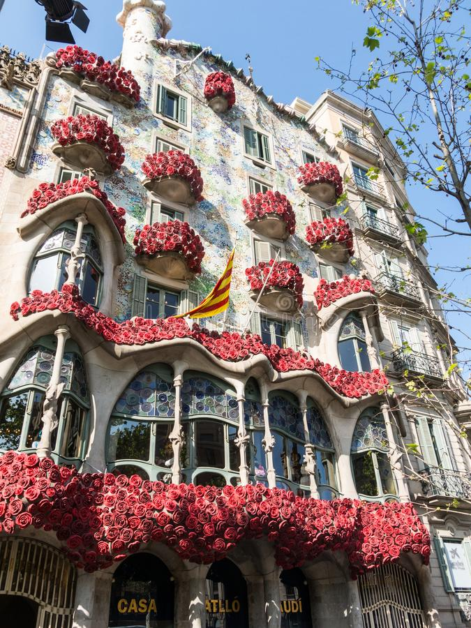 The Casa Batlló by Antonio Gaudí, decorated to celebrate the Day of the Rose in Catalonia. Paseo de Gracia, Barcelona. BARCELONA, SPAIN - APRIL 20: The Day stock image