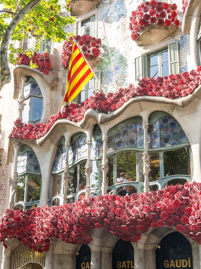 The Casa Batlló by Antonio Gaudí, decorated to celebrate the Day of the Rose in Catalonia. Paseo de Gracia, Barcelona. BARCELONA, SPAIN - APRIL 20: The Day stock photos