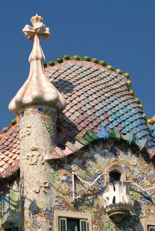 Casa Batllo - Barcelona. Casa Batllo is part of Manazana de la Discordia, 'Block of Discord', in Barcelona. Antoni Gaudi's artistic roof top respresenting st stock photo