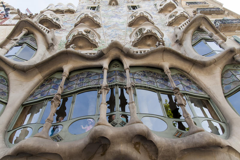 Casa Batllo in Barcelona. Unidentified people at Casa Batllo in Barcelona, Spain. This expressionist house was redesigned in 1904 by Antoni Gaudi royalty free stock photos