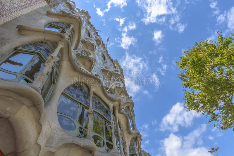 Casa Batllo, Eixample District, Barcelona, Spain. Barcelona - July 16: The facade of the house Casa Battlo designed by Antoni Gaudi on July 12, 2014 Barcelona royalty free stock photos