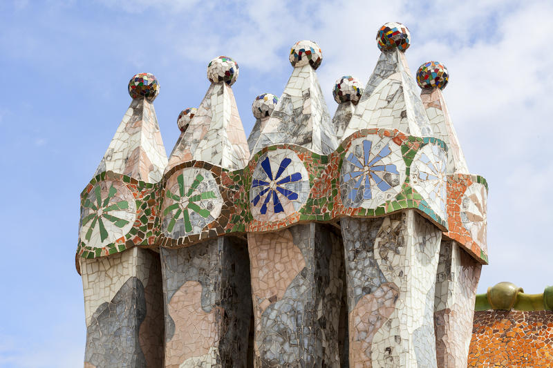 Casa Batllo, housetop , chimneys with ceramic mosaic, Barcelona. Barcelona, Spain - May 11,2016 : Casa Batllo, housetop , chimneys with ceramic mosaic. Building royalty free stock images