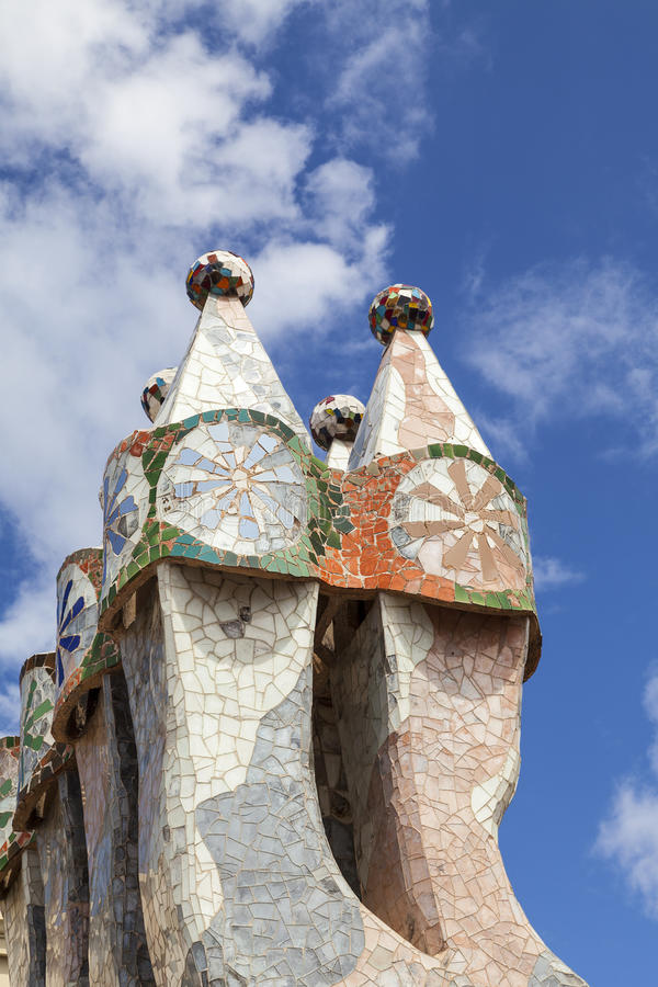 Casa Batllo, housetop , chimneys with ceramic mosaic, Barcelona. Barcelona, Spain - May 11,2016 : Casa Batllo, housetop , chimneys with ceramic mosaic. Building royalty free stock image