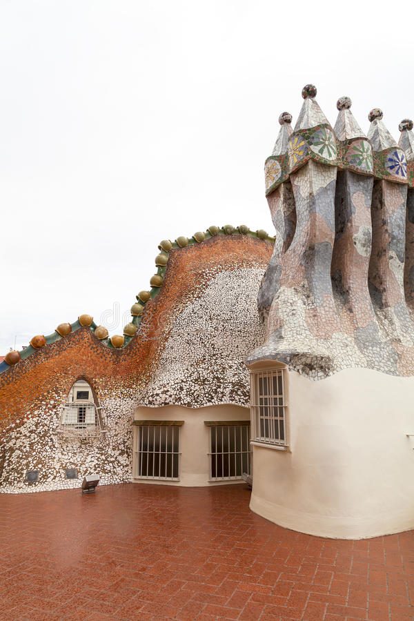 Casa Batllo, housetop , chimneys with ceramic mosaic, Barcelona. Barcelona, Spain - May 11,2016 : Casa Batllo, housetop , chimneys with ceramic mosaic. Building royalty free stock photography