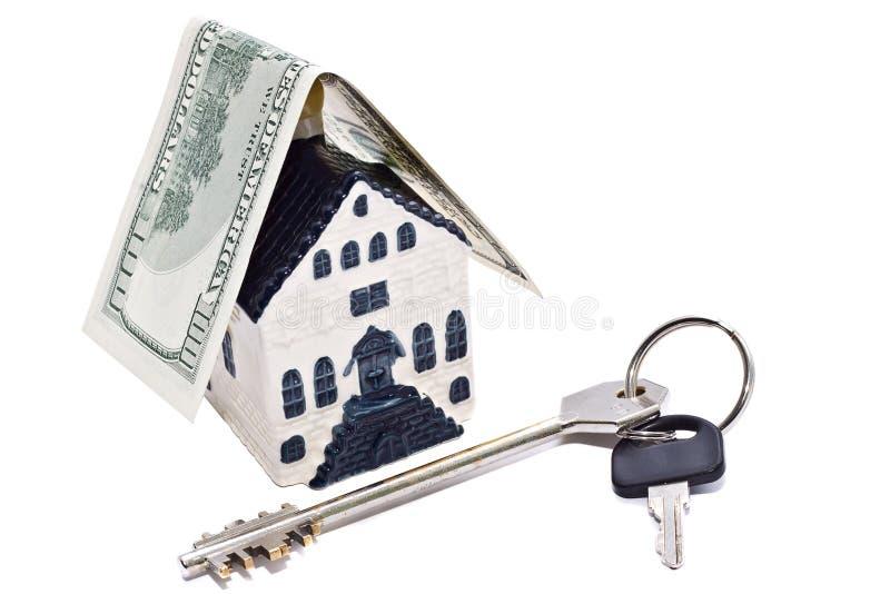 Casa, chave e dólar fotografia de stock royalty free