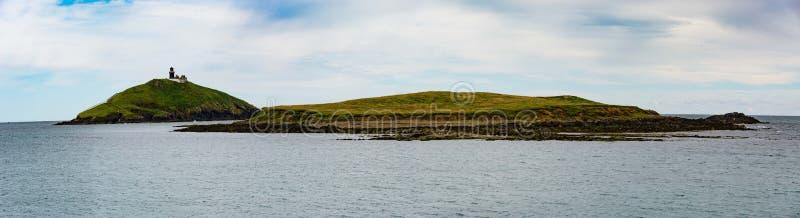 Casa clara & ilha de Ballycotton fotos de stock royalty free