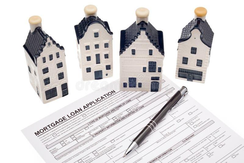 Casa con el uso de préstamo de hipoteca fotografía de archivo