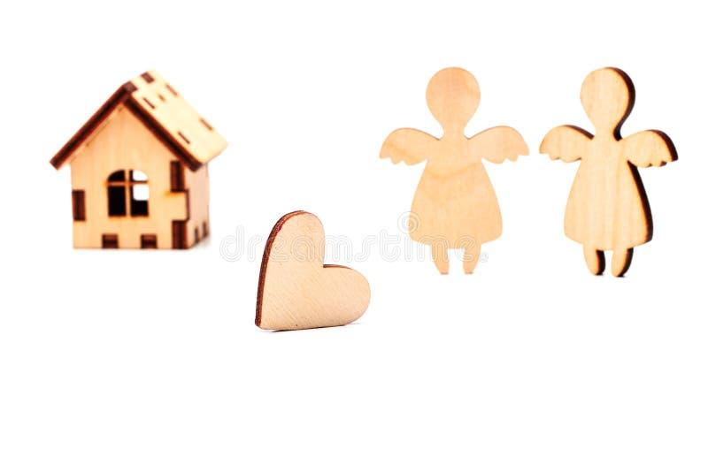 Casa, corazón y ángel de madera foto de archivo libre de regalías