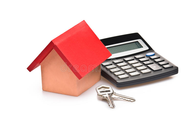 Casa cubierta roja con claves de la calculadora y de la casa imagenes de archivo