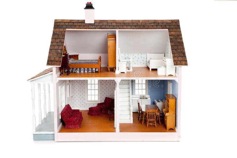 Casa de boneca da criança com mobília no branco fotografia de stock