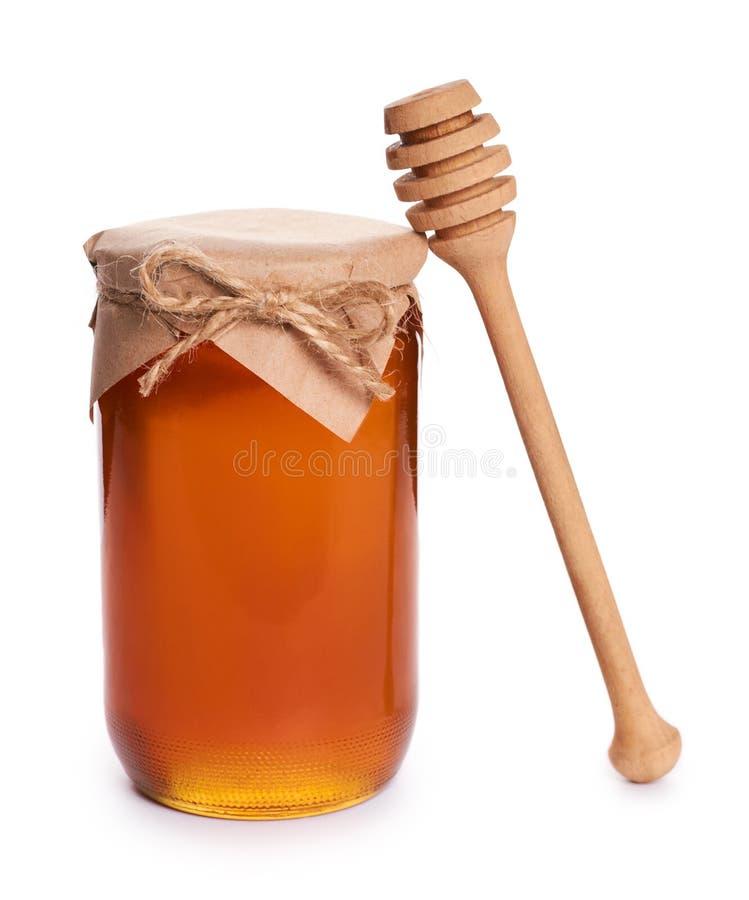 A casa de Eco fez o mel no frasco isolado no fundo branco imagem de stock royalty free