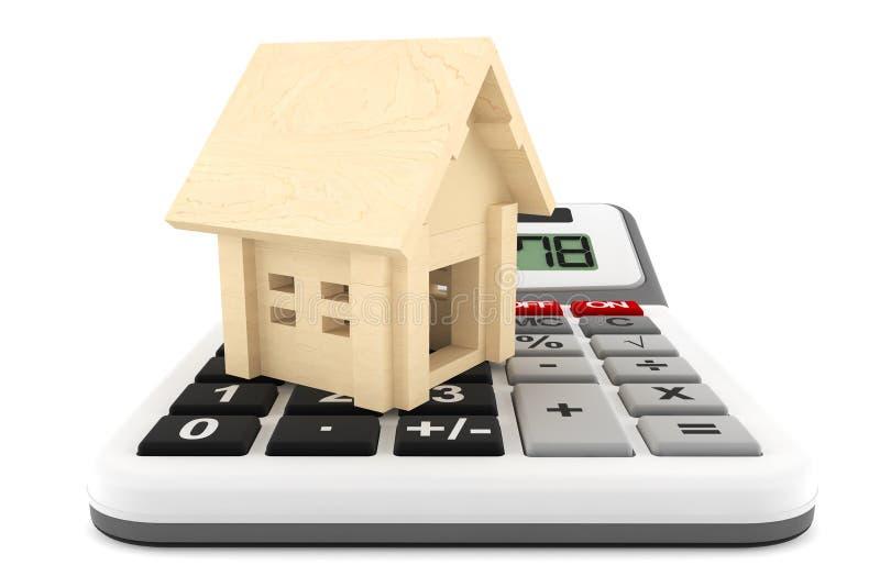 Casa de madeira com calculadora fotos de stock royalty free