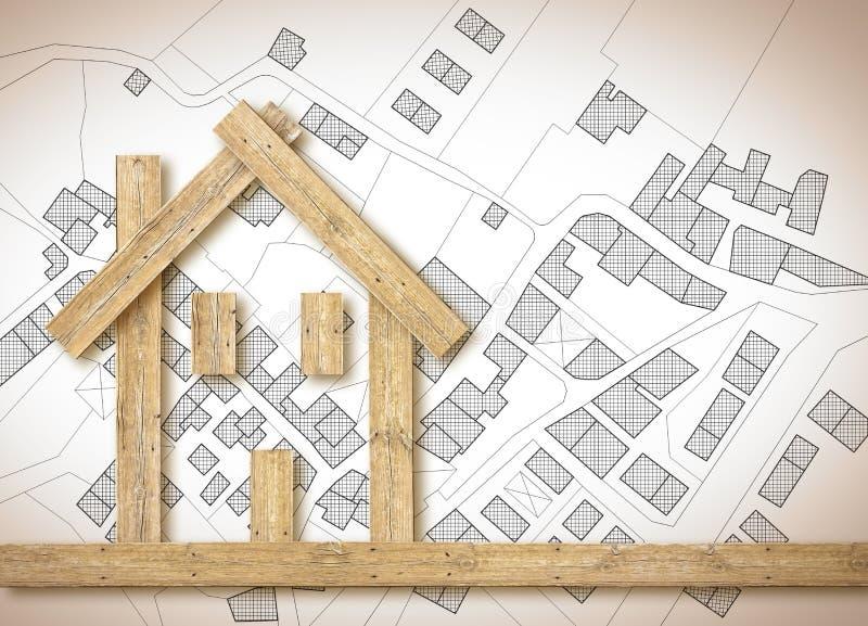Casa de madeira conceptual sobre um mapa cadastral imagin?rio do territ?rio com constru??es, campos e estradas - imagem do concei foto de stock