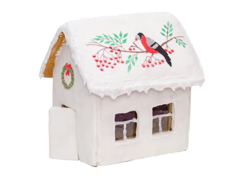 Casa de pan de jengibre de la Navidad con un pájaro y un rojo imagen de archivo libre de regalías