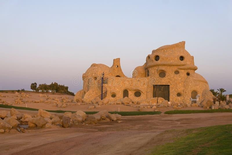Casa de piedra extraña fotografía de archivo libre de regalías