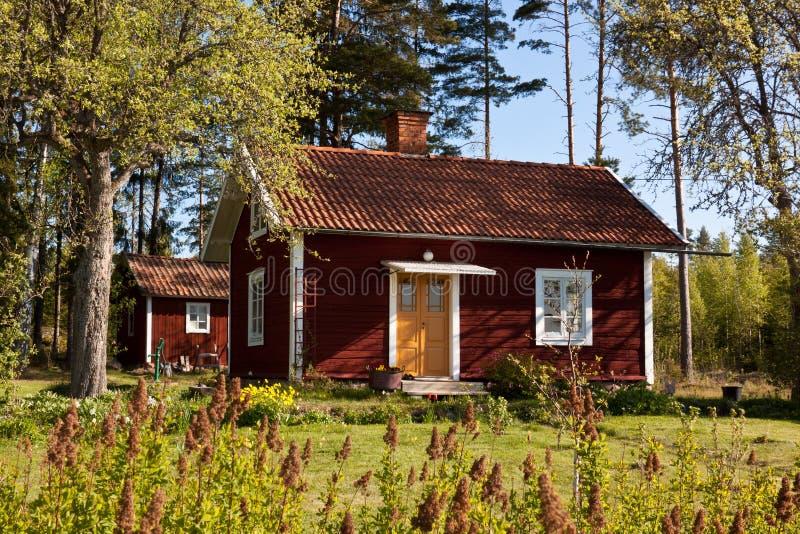 Casa de verão sueco. imagens de stock