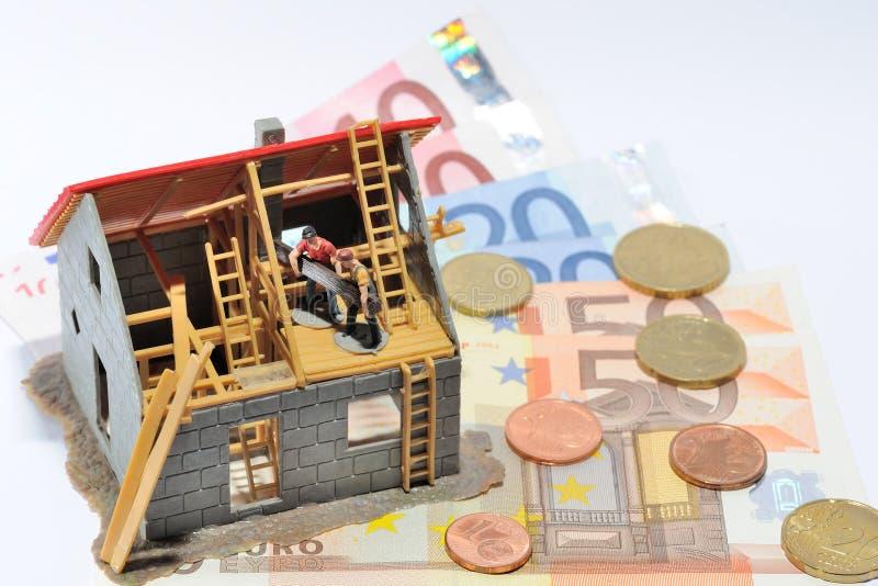 Casa e dinheiro fotografia de stock royalty free