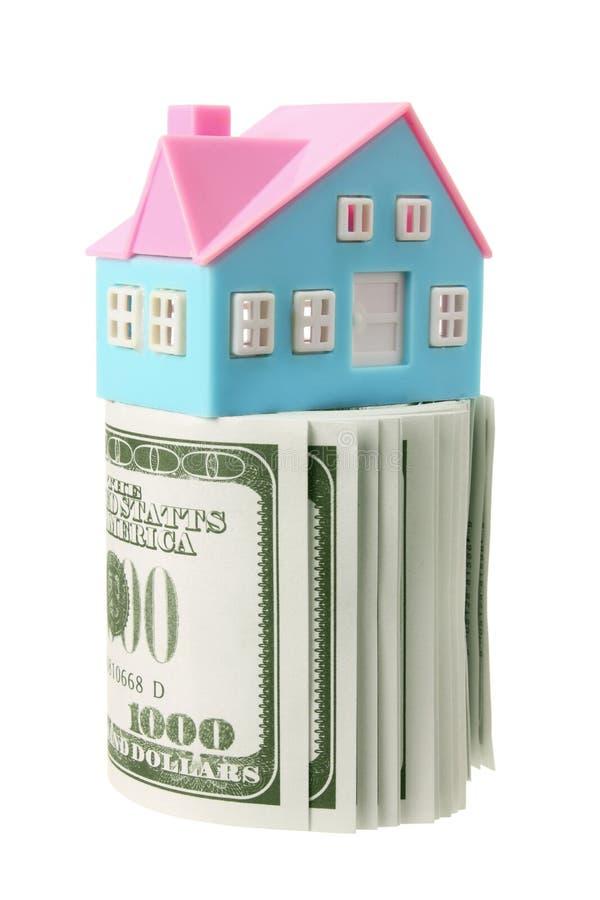 Casa e notas de banco diminutas fotos de stock royalty free