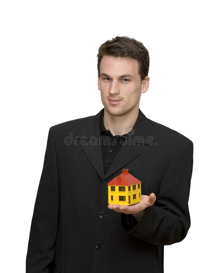 Casa em uma mão imagens de stock royalty free