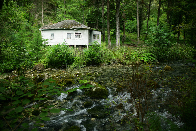 Casa en la batería del río foto de archivo libre de regalías