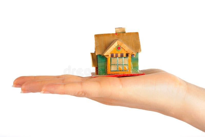 Casa en la mano imagen de archivo