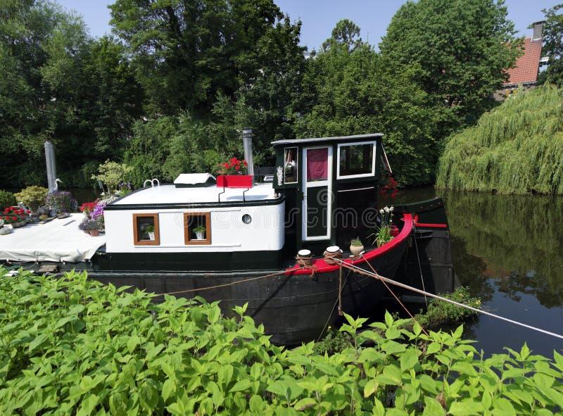 Casa galleggiante in canale fotografia stock