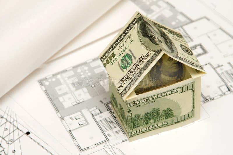 Casa hecha del dinero imagen de archivo