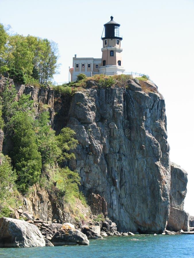 Casa ligera de la roca partida fotografía de archivo