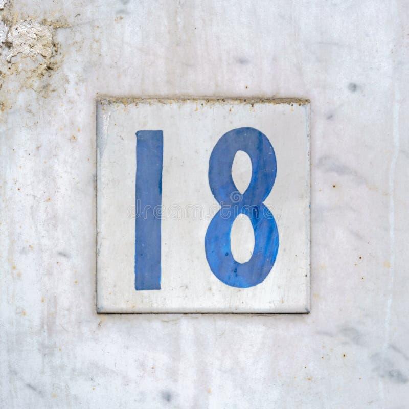 Casa número 18 en una teja cuadrada fotos de archivo libres de regalías