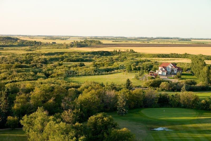 Casa no campo de golfe fotos de stock