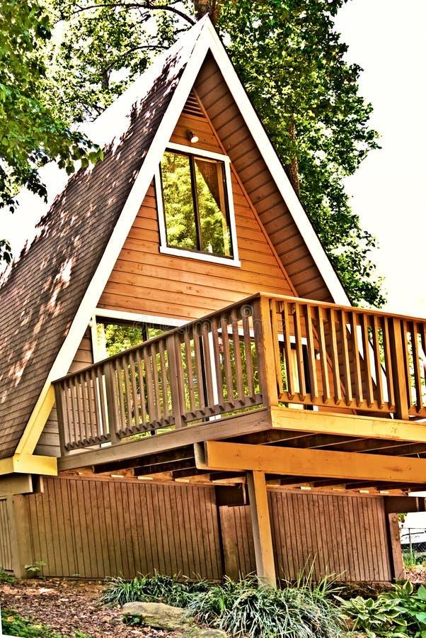 Casa/plataforma de madeira do Um-Frame fotos de stock