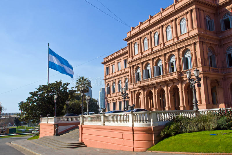 Casa Rosada and flag in Argentina. The Casa Rosada and an argentinean flag in Buenos Aires, Argentina stock image
