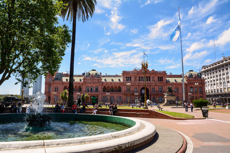 Casa Rosada in Plaza de Majo in Buenos aires with tourist in a s. Buenos Aires, Argentina - October 30, 2016: Casa Rosada in Plaza de Mayo in Buenos aires with royalty free stock photo