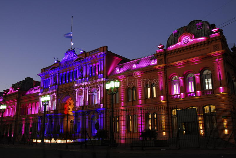 Casa Rosada at Night. Evening image of Casa Rosada in Buenos Aires. The building is bathed in gold, blue and pink lights royalty free stock images