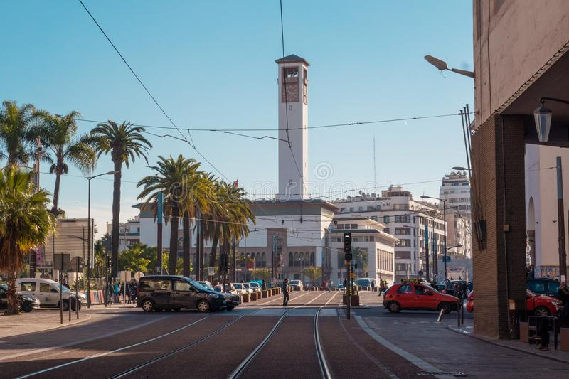 Cityscape of Casablanca - Morocco. Casablanca, Morocco - December 18, 2017 : Scenic view of casablanca`s clock tower and street car railways royalty free stock photos
