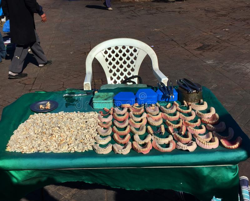 Dentist`s table with dentures and teeth in central Morocco market. Casablanca - Morocco, July 20, 2018, Dentist`s table with dentures and teeth in central royalty free stock photos