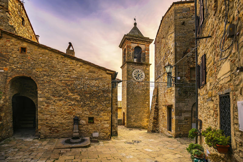 Casale Marittimo old stone village in Maremma. Picturesque flowery square and campanile tower. Tuscany, Italy. Casale Marittimo old stone village in Maremma on stock image
