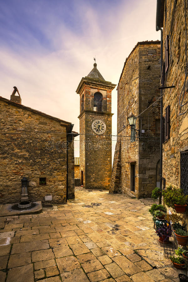 Casale Marittimo old stone village in Maremma. Picturesque flowery square and campanile tower. Tuscany, Italy. Casale Marittimo old stone village in Maremma on royalty free stock images