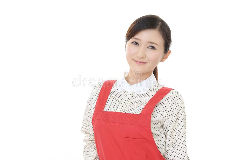 Casalinga asiatica sorridente fotografie stock libere da diritti
