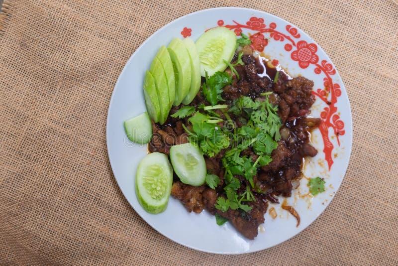Casalingo tailandese, scalpore dell'alimento ha fritto la carne di maiale con lo zucchero fotografia stock libera da diritti