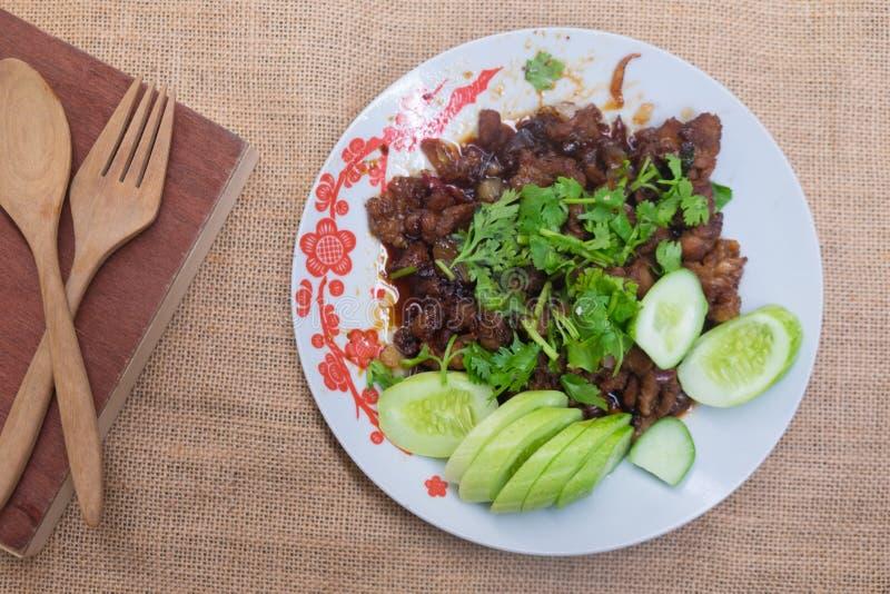 Casalingo tailandese, scalpore dell'alimento ha fritto la carne di maiale con lo zucchero immagini stock